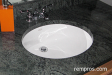 Glass vessel vs ceramic undermount bathroom sink for Tempered glass countertop vs granite