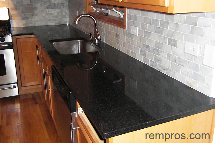 granite kitchen countertop in combination with marble tile
