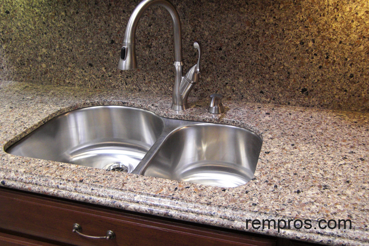 quartz kitchen countertop with quartz backsplash and undermount sink