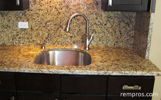 venetian gold granite countertop with backsplash