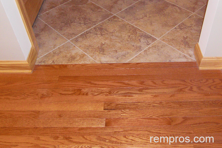 Solid wood flooring in transition with porcelain tile